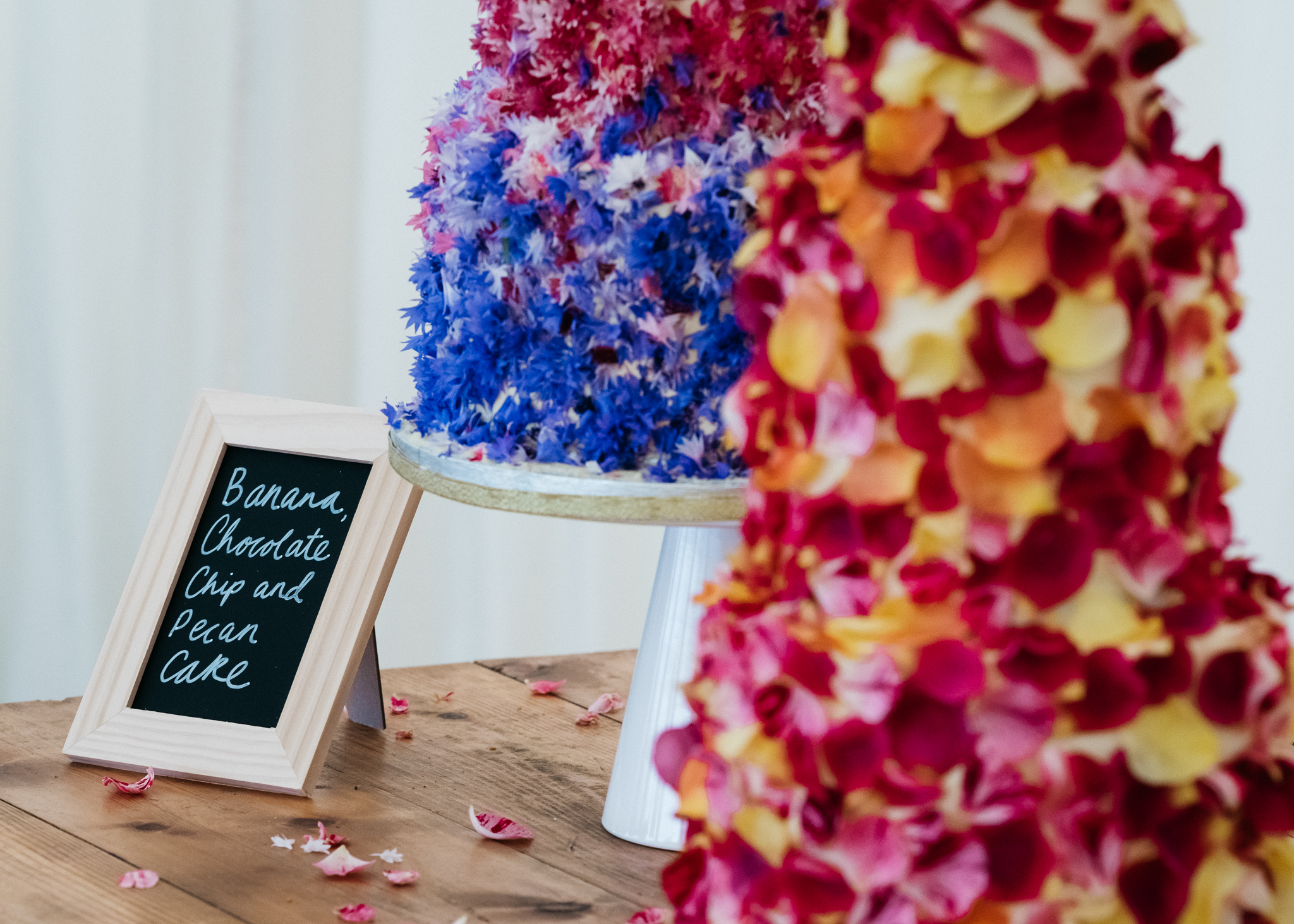 Buttercream wedding cakes with edible petals