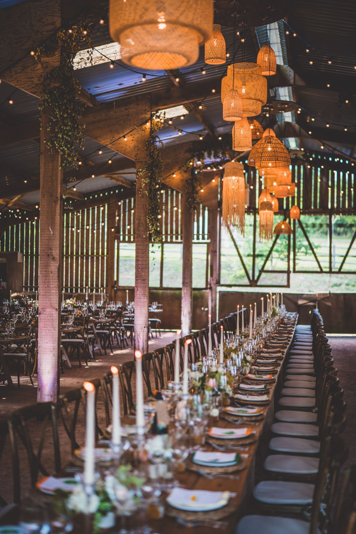 Barn Wedding In Devon With Rattan Details And Festoon Lights