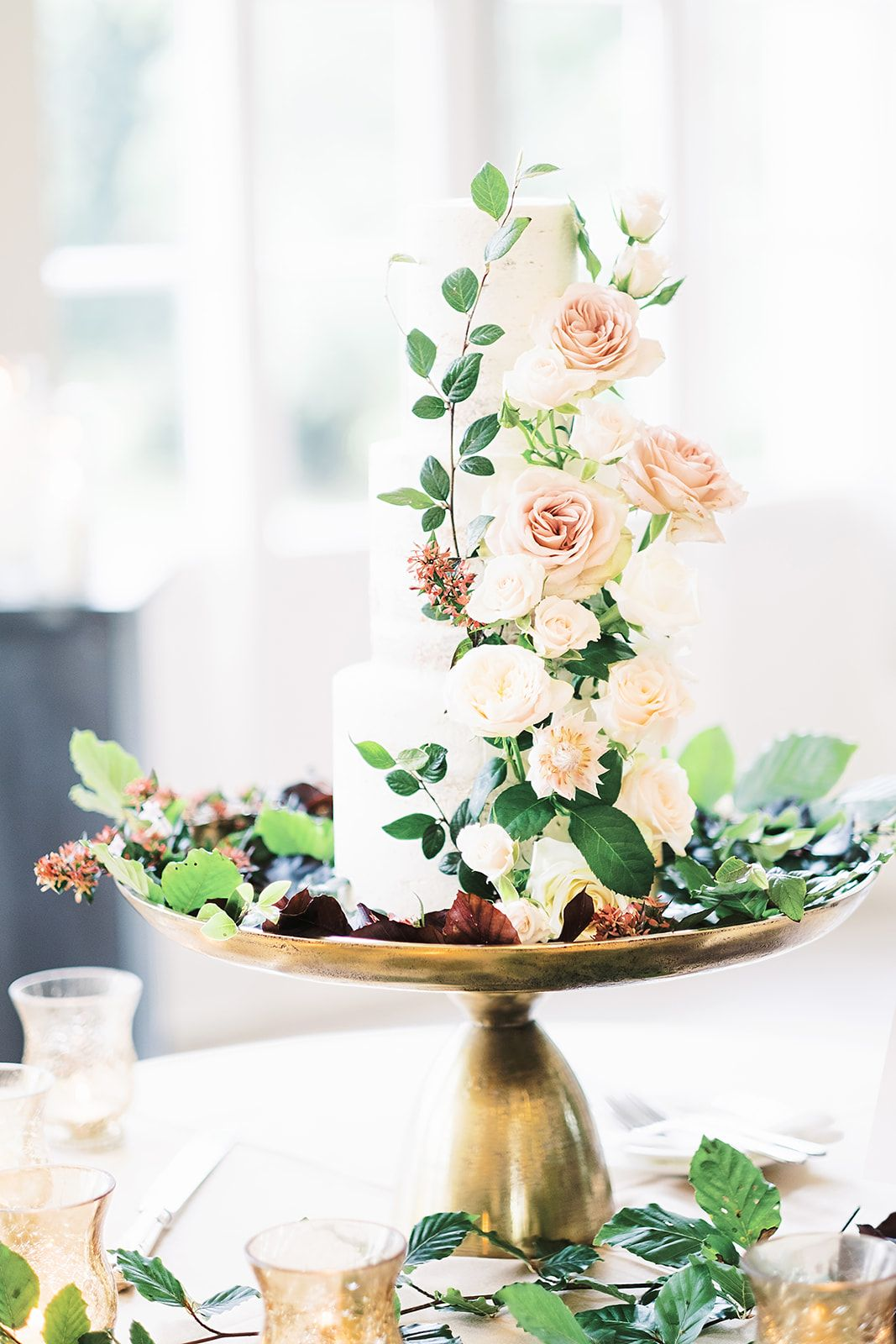 Buttercream Wedding Cake With Fresh Flower Decorations