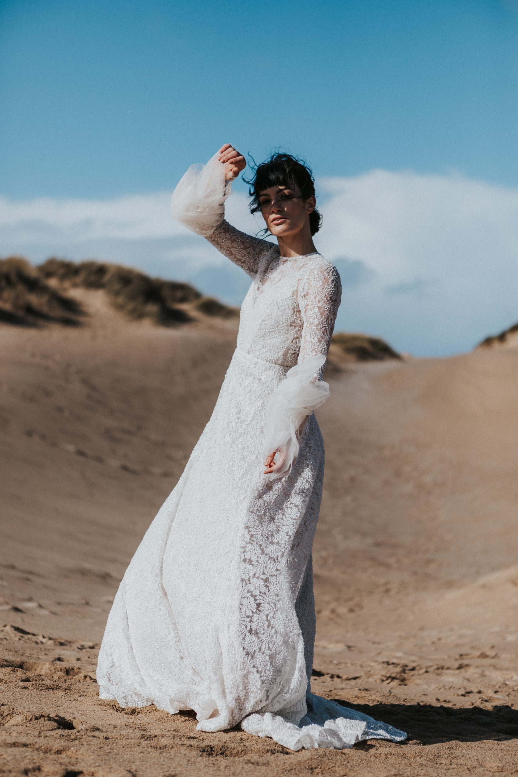 Bride In Bell Sleeved Wedding Dress On The Beach