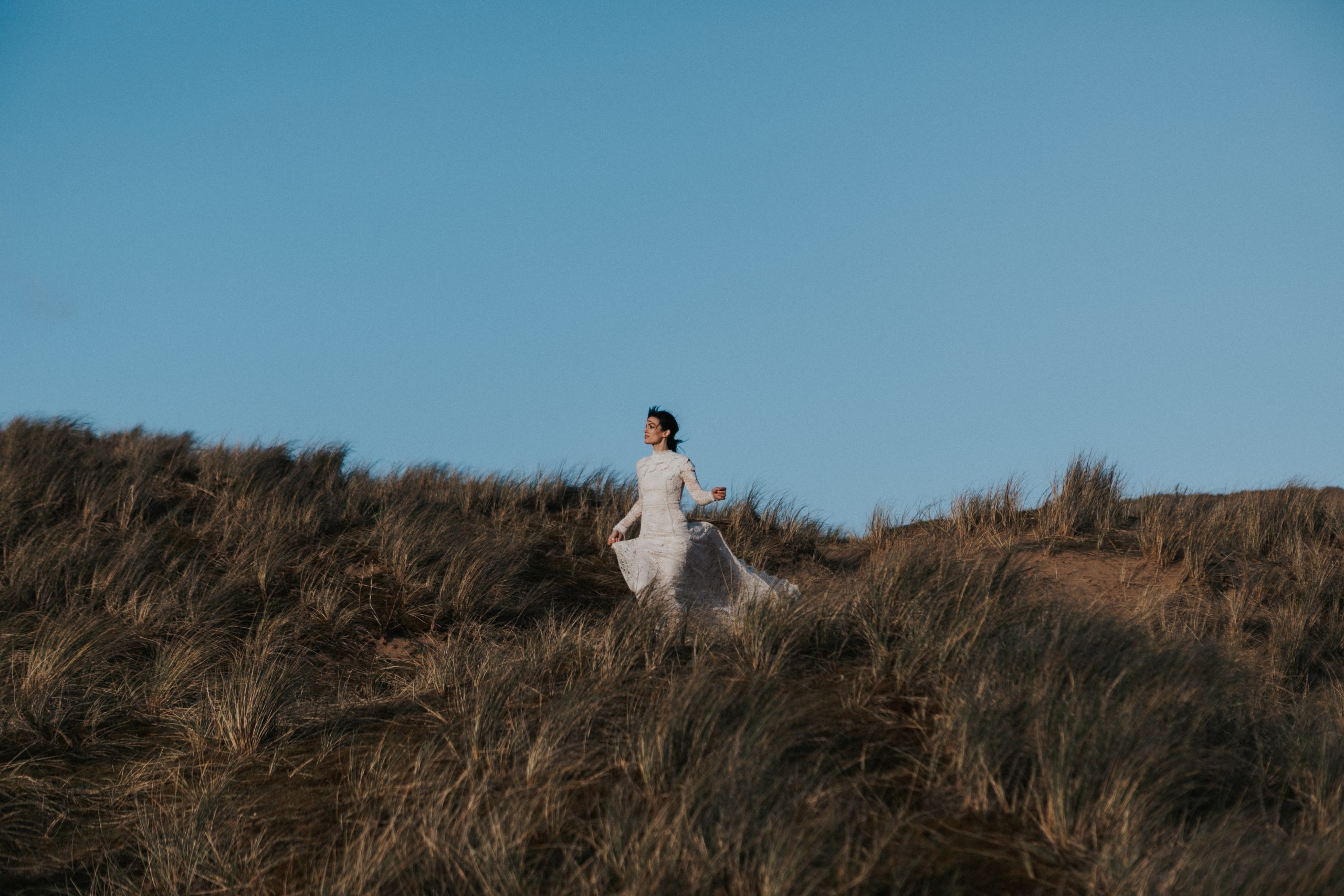 Bride On Beach At Golden Hour